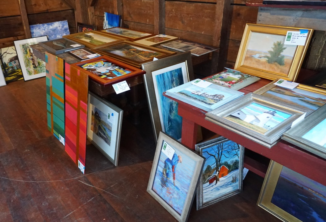 artwork at Art in the Barn, colorful canvases