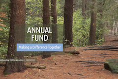 Wooded trail with Annual Fund banner