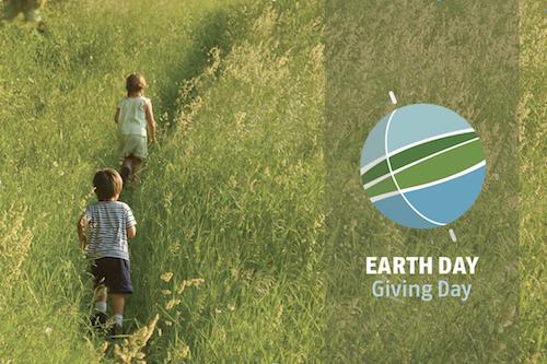 Earth Day logo, children running through fields of tall gras