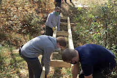 Eagle Scouts building bridge at Woodland Acres